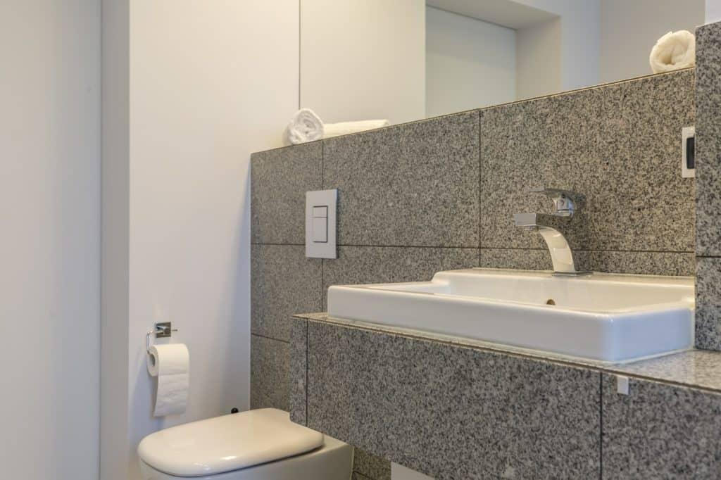 Granite tiles in minimalist bathroom