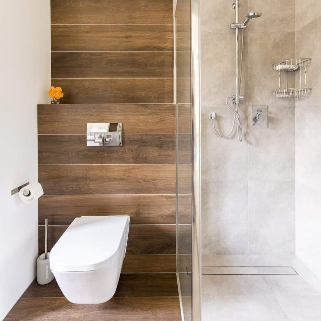 Bathroom with wood and travertine decor