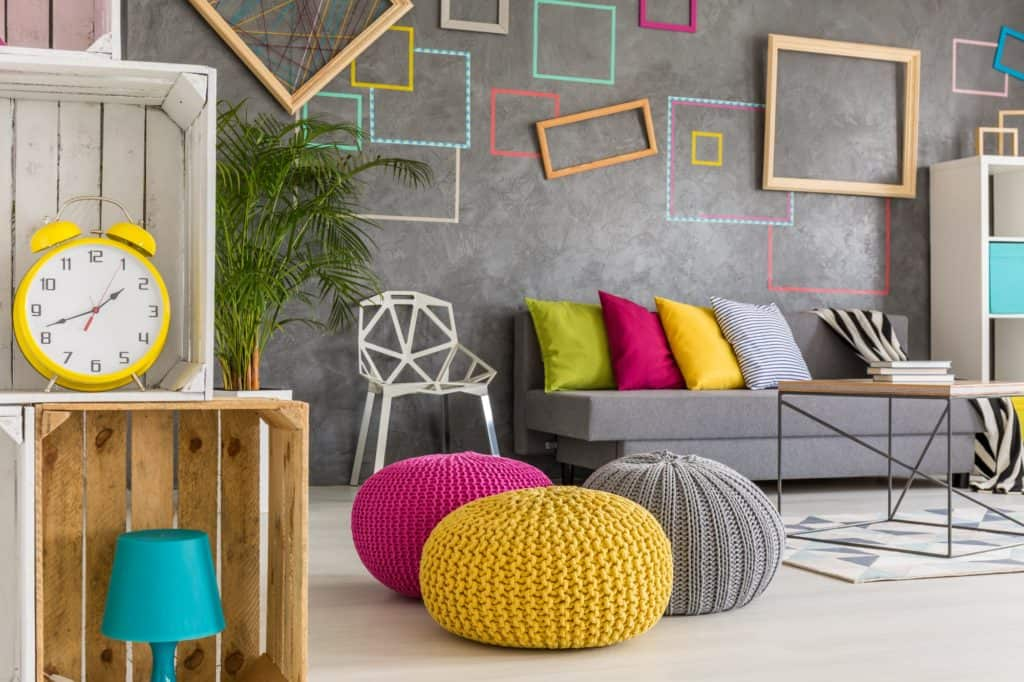 Hipster room with colorful poufs