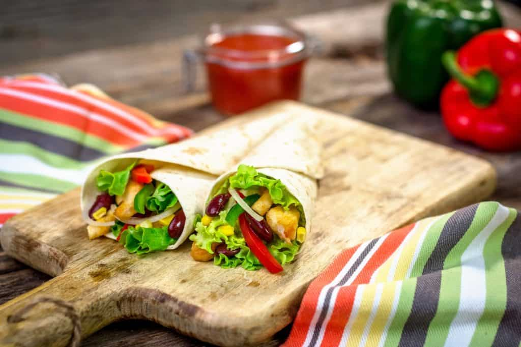 Meat and vegetables wrapped in a tortilla