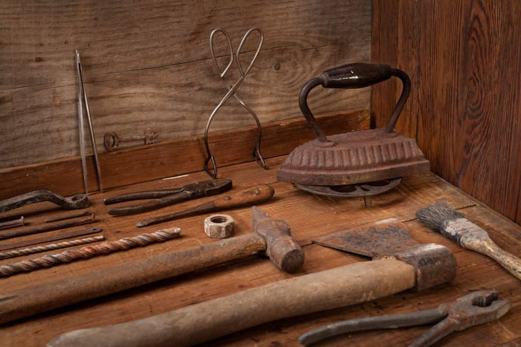 Collection of vintage tools on a blue wooden background