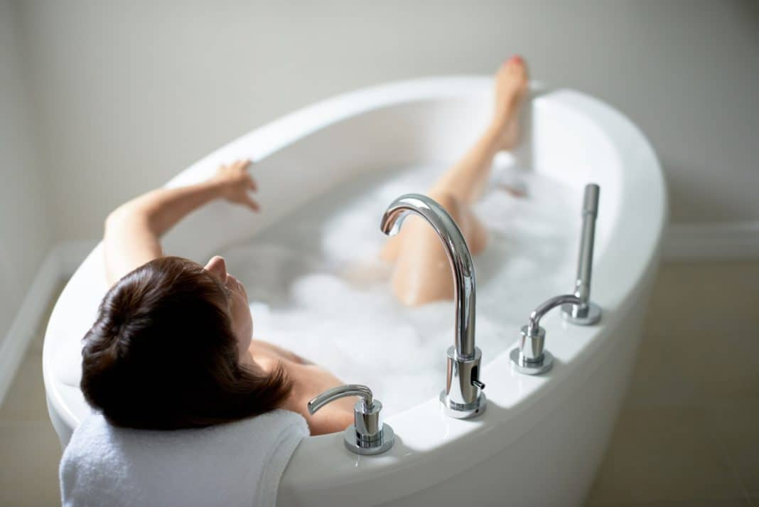 Top view of a serene mature woman in bathtub